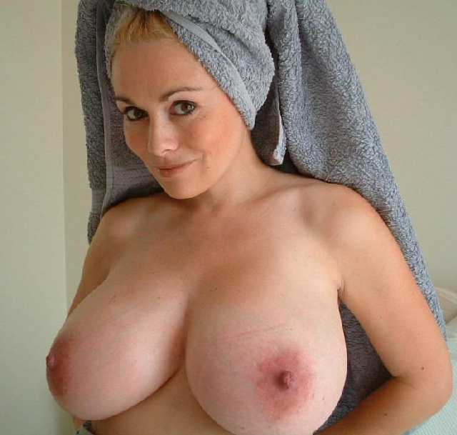 Busty MILF who looks hot and sexy just coming out of the bath with a ...