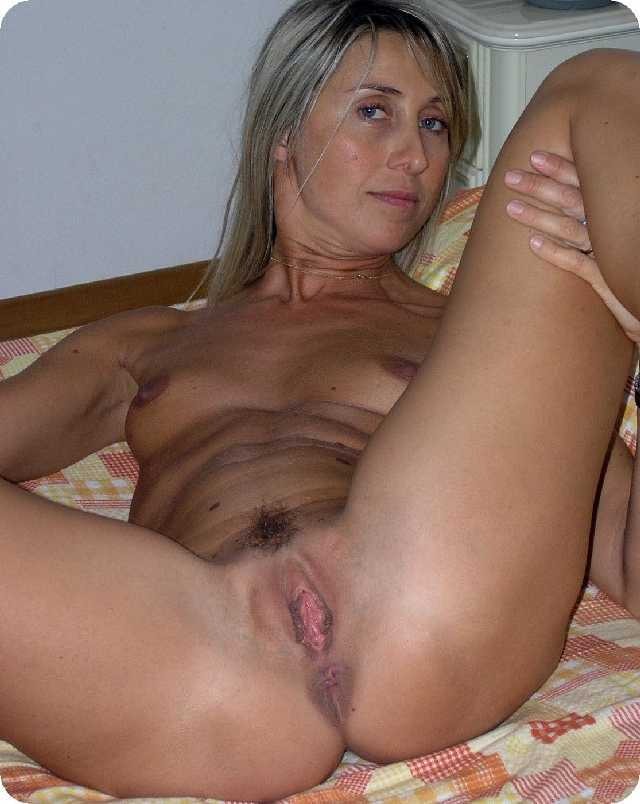 Mature MILF above with her legs apart showing off a pussy and her ...